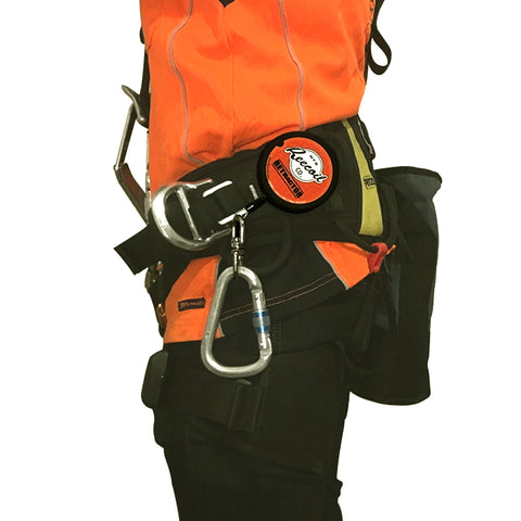 Retractable lanyard on fall arrest harness