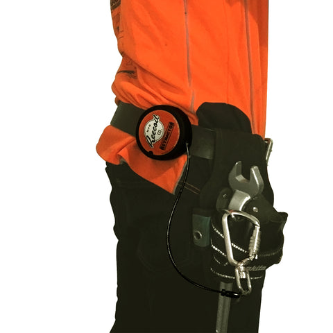 retractable lanyard and carabiner on tool belt next to tool pouch