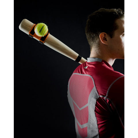 a guy holding the LineDrivePro Swing Trainer for baseball