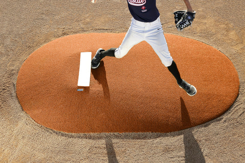 clay pitching mound with durable turf and reinforced fiberglass