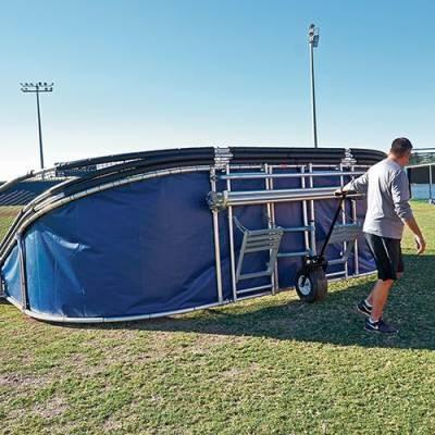 big bubba elite backstop being taken off field with portable wheels
