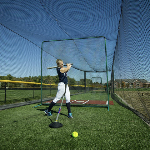 woman hitting promounds pvtee batting tee in batting cage