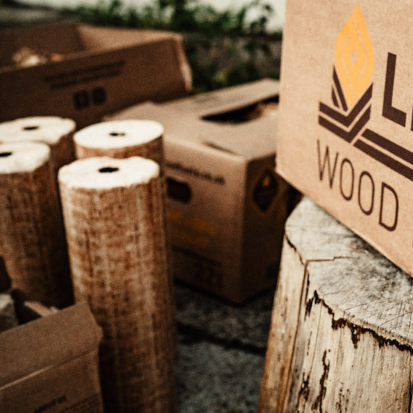 4x Lekto Wood Fuels Hardwood Heat Logs surrounded by boxes
