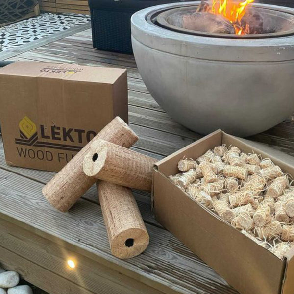 Lekto Wood Fuels Natural Firelighters and Hardwood Heat logs on wooden decking next to a fire pit