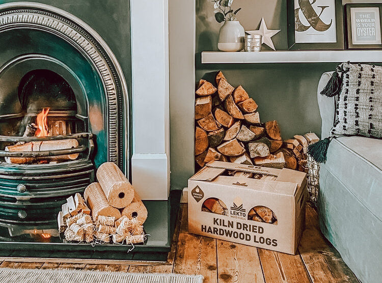 Lounge Setting with Lekto Wood Fuels Hardwood Heat Logs and Natural Firelighters next to a fireplace