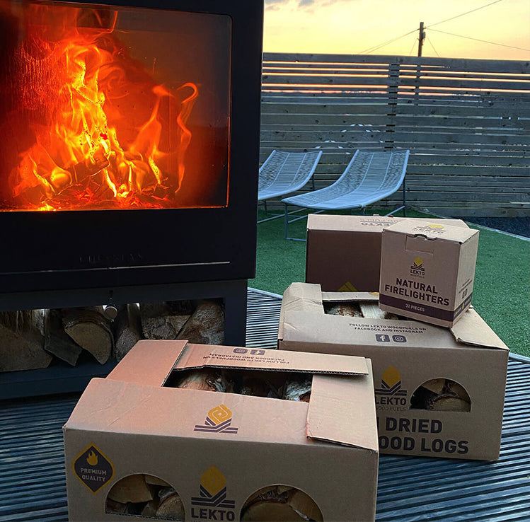 Kiln Dried Firewood by an outdoor wood burning Stove