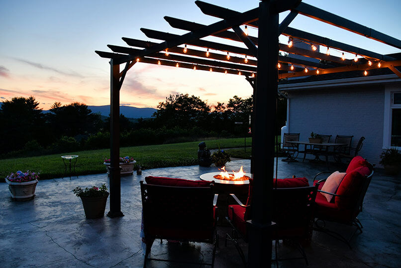 Outside Seating Area With Fire Pit Table
