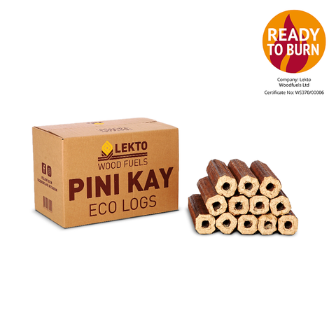 A box of Lekto Pini Kay briquettes next to the product