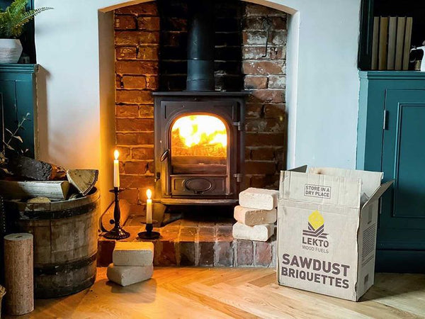 Sawdust Briquettes Next To A Wood Burning Stove