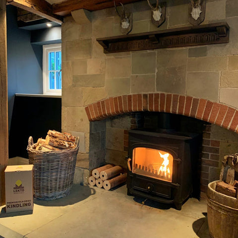 Indoor Log Burner In a kitchen setting, surrounded by Lekto Wood Fuels' products