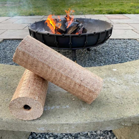 Lekto Heat Logs in front of a burning fire pit.