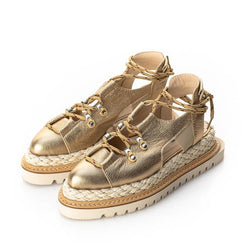 Golden leather flat shoes