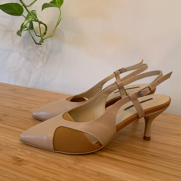 Beige leather pumps