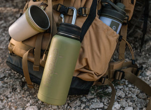 Earthwell stainless steel insulated bottle hanging from rucksack