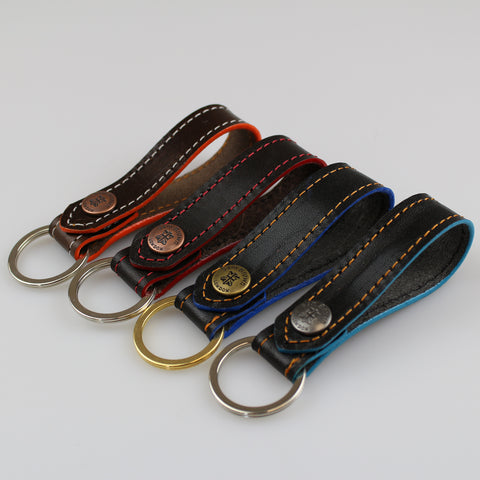 Great gift. Key rings can be attached to jeans loops, your bag 100% British leather eDGE DYED in blue-orange-aqua-red made by us Sam Brown London UK
