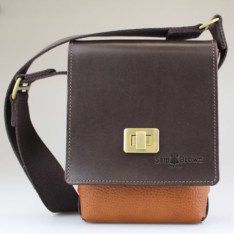 Compact across-body-bag English bridl leather with brass turn lock in  tan & brown leather with Harris Tweed lining & leather pocket Sam Brown London made in Wiltshire UK
