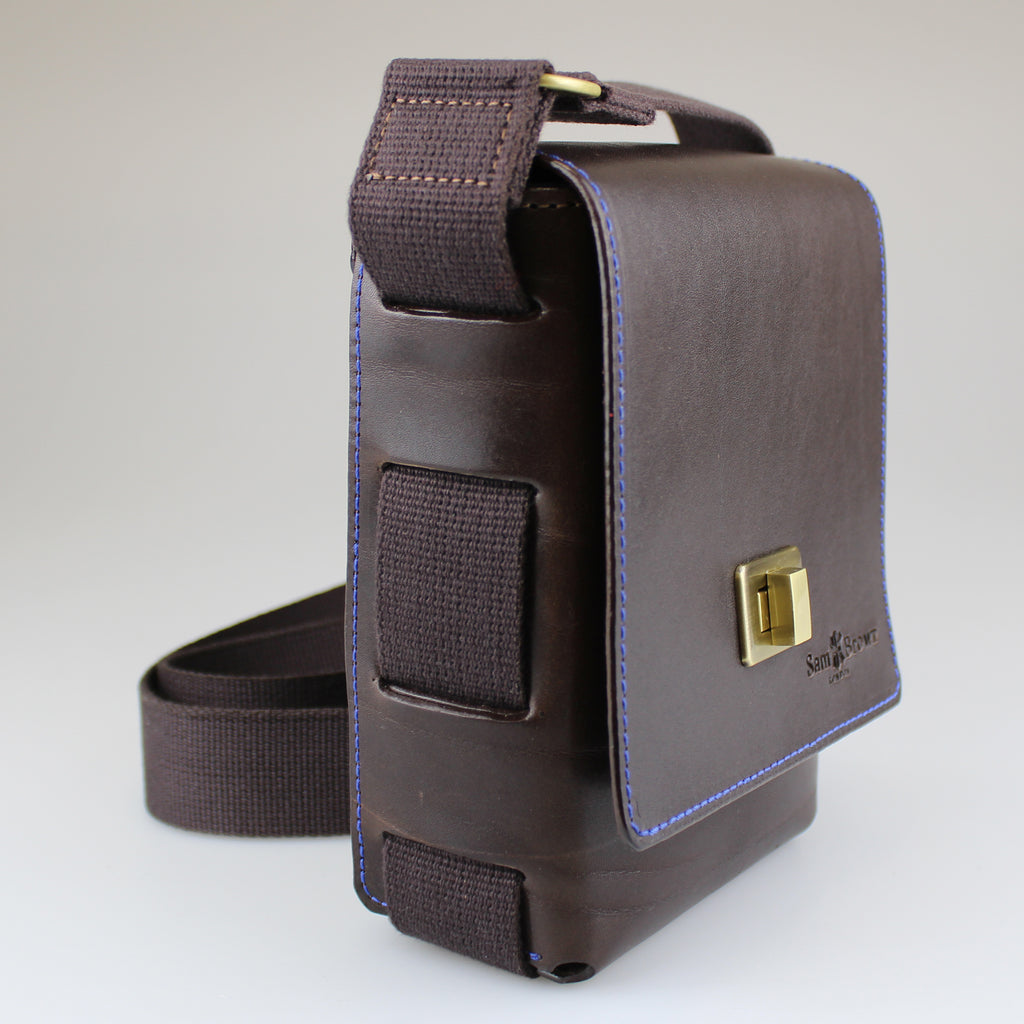 side angle view showing cotton webbing on Dark-brown-English-bridal-leather-with-brushed-brass-turnlock Across body bag  Made by Sam Brown London Wiltshire UK