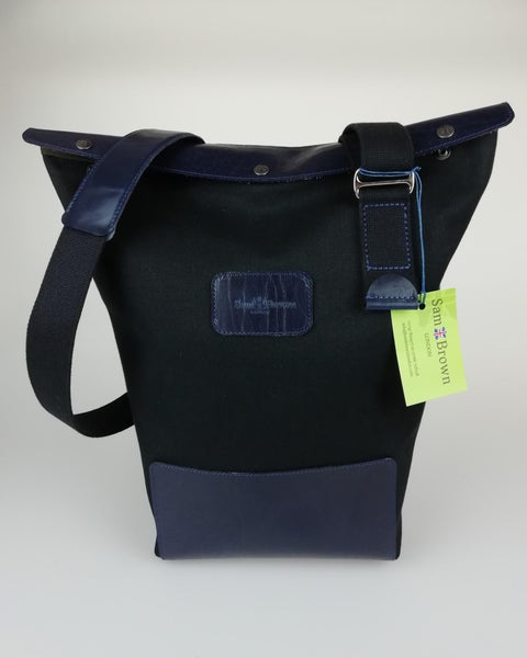 Black canvas with Blue leather trim across body bag sam brown london