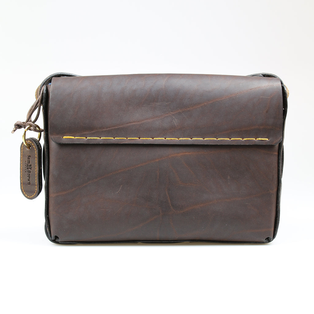 Back of Custom raw edge Poacher Bag across body Bag Brown leather bag Hand stitched made in England by Sam Brown London