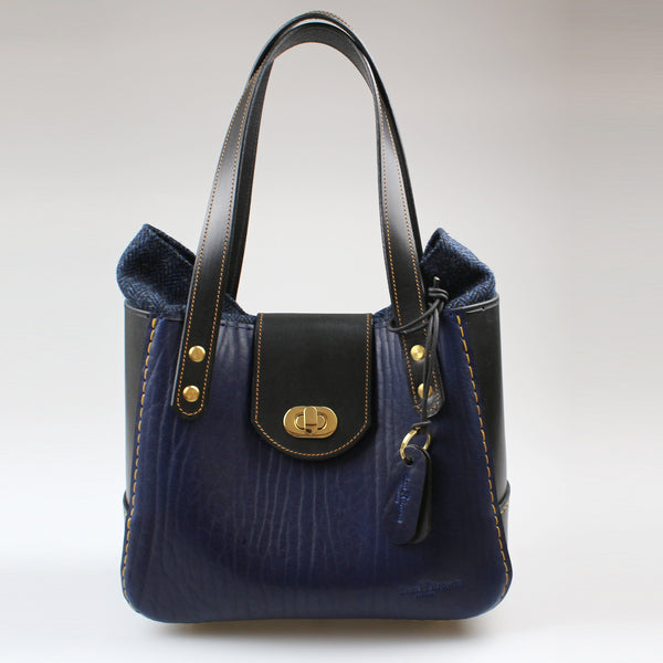 The Bromley Bag is classic timeless shape lots of space wide flap and overlapping fabric for stylish looks and security