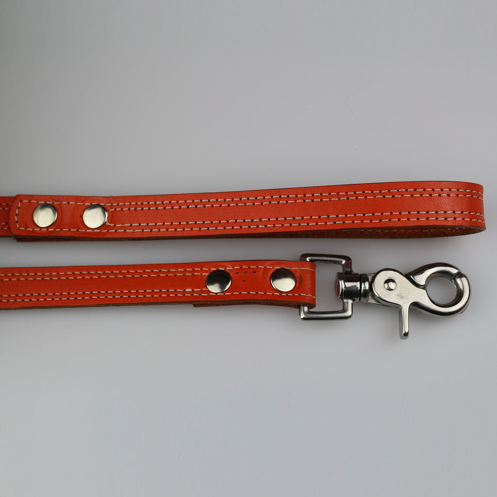 bright orange leather with white stitch detail nickel fixings made UK by Sam Brown London