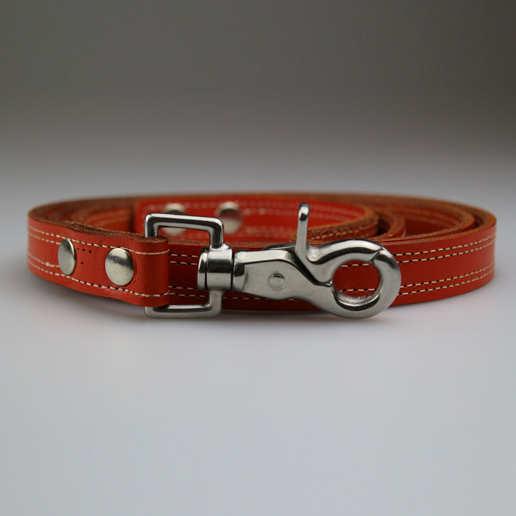 English bridle orange leather with white stitch detail nickel fixings made UK by Sam Brown London
