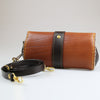 rear view Ladies womens Hand held English leather clutch bag with detachable & adjustable across the body strap