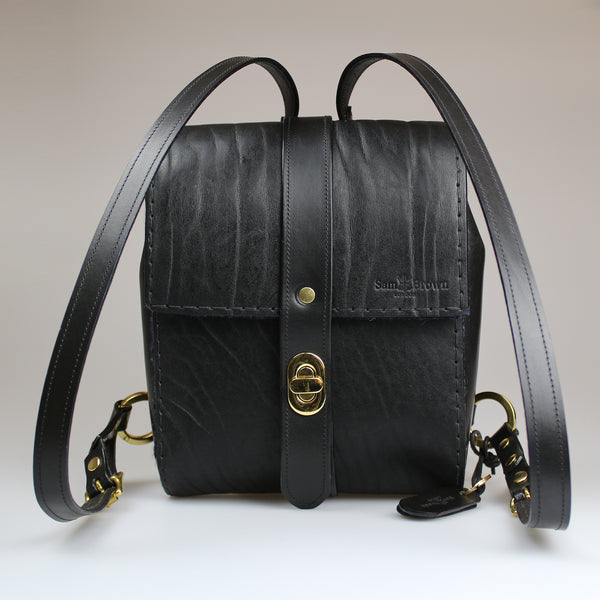 The Malvern Backpack traditional British black full grain bridle leather hand stitched in black waxed linen Harris Tweed liner & pockets made by Sam Brown London in Wiltshire UK