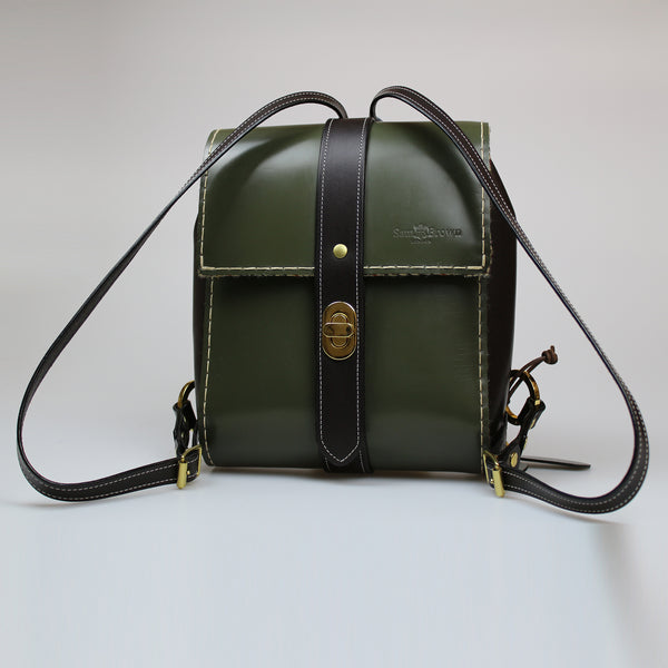 The Malvern Backpack traditional British bridel leather olive green & brown Harris Tweed liner & pockets made by Sam Brown London in Wiltshire UK