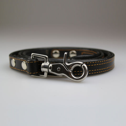 black orange leather with yellow stitch detail nickel fixings made UK by Sam Brown London