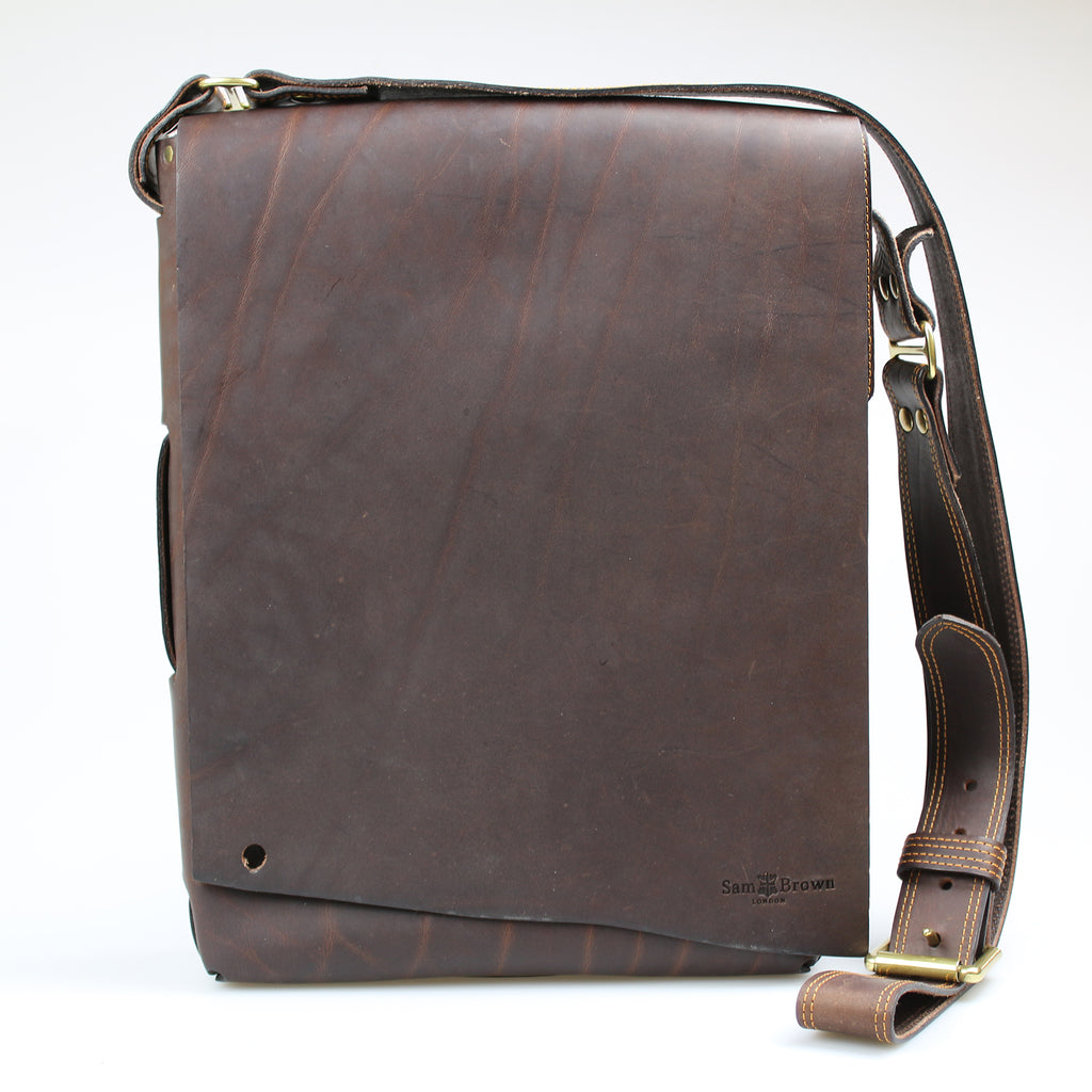 Custom raw edge Bow Postal Bag across body Brown performance leather bag made in England by Sam Brown London