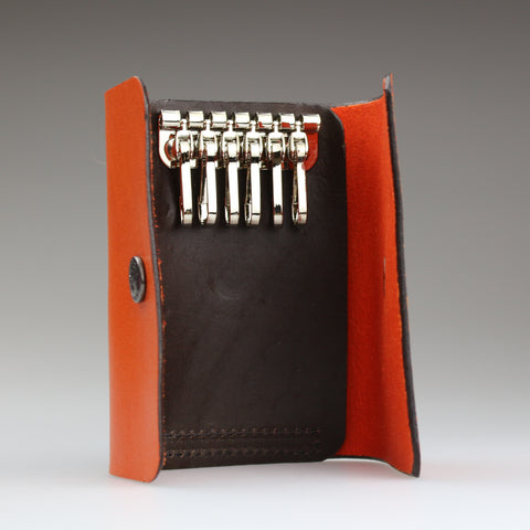 Key case in 2 tone orange & brown British bridle leather handmade to order by Sam Brown London studios in Wiltshire