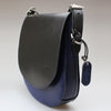 Side view of Classic Saddle Bag shoulder strap with press stud folio