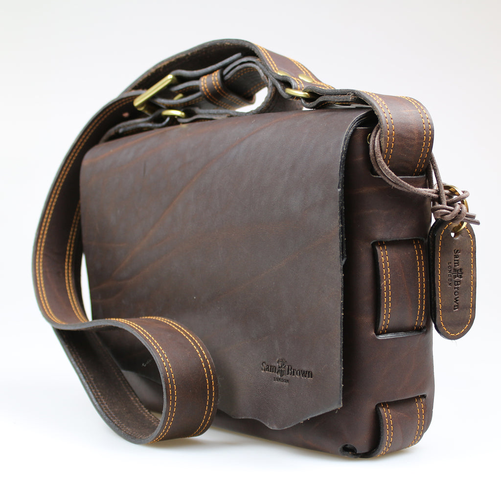 Custom raw edge Poacher Bag across body Brown performance leather bag made in England by Sam Brown London