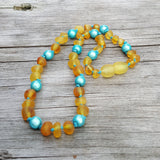 Baltic amber teething necklace - Unpolished amber with aqua magic beads