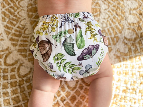 a baby wearing night time cloth nappy