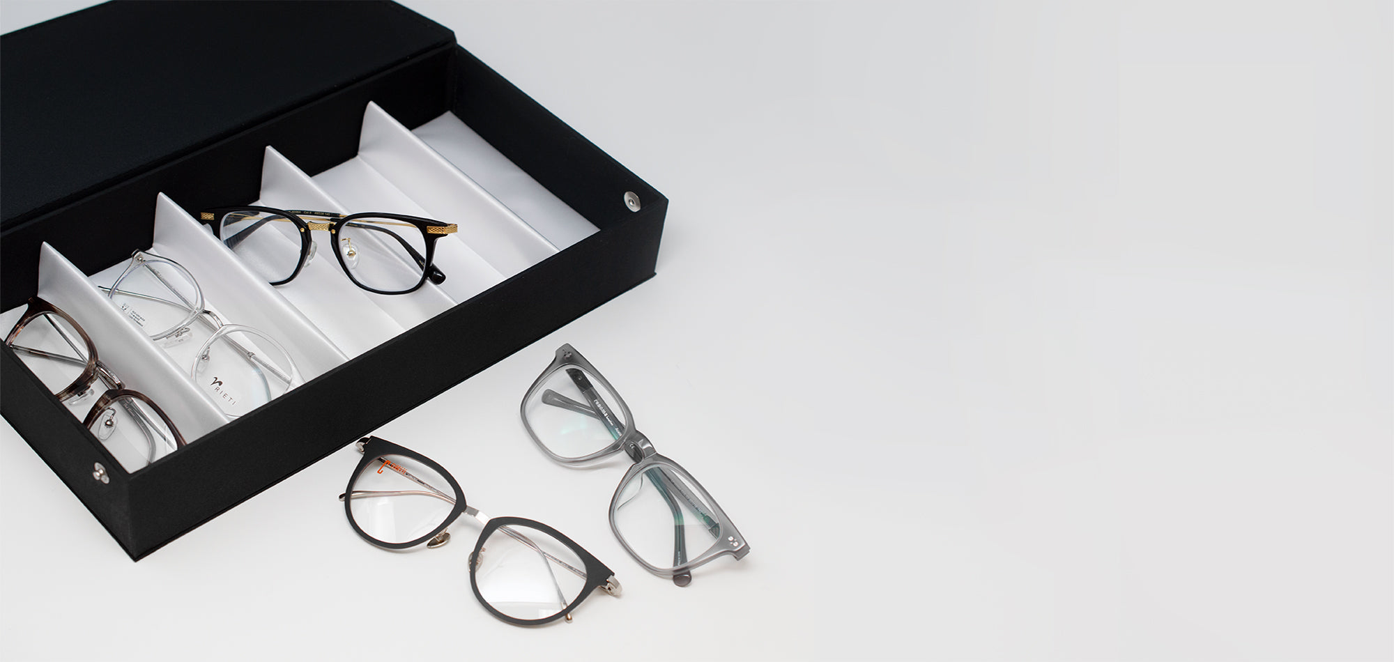 Black try on box with five various asian fit glasses