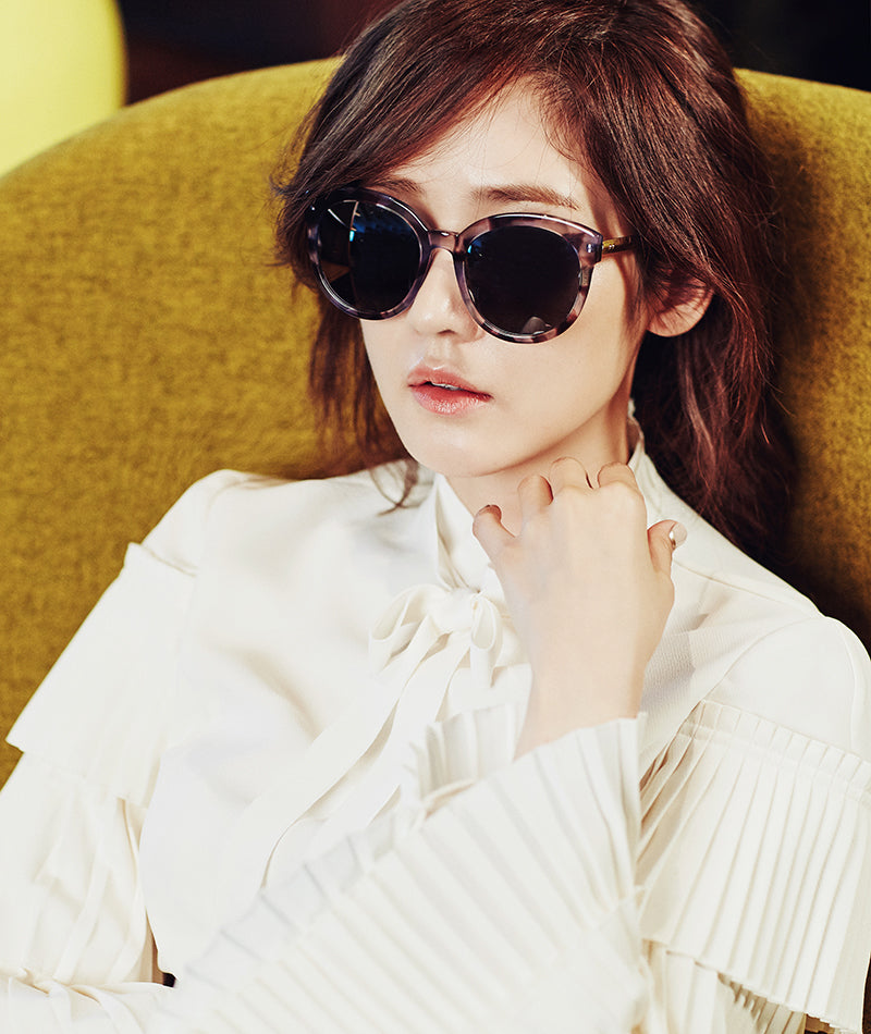 Sung Yuri wears oversize marble purple tortoise sunglasses