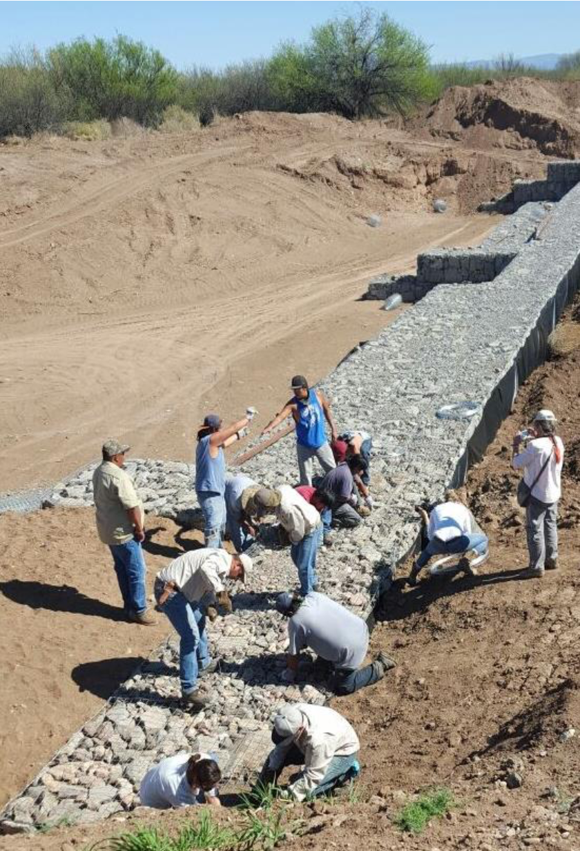 Men building a rock dam