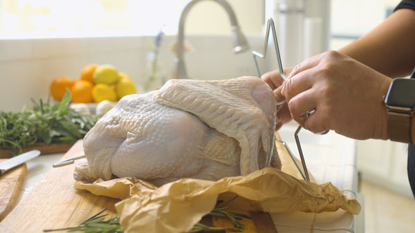 Turkey Frying Tip: Insert the star-shaped turkey lifter into the cavity so the legs are facing upward