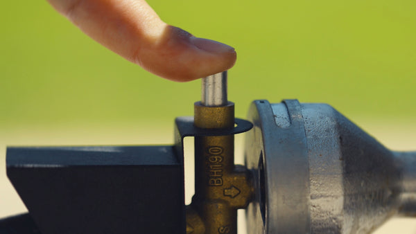 When you light the burner, hold down the safety valve for 10-15 seconds.