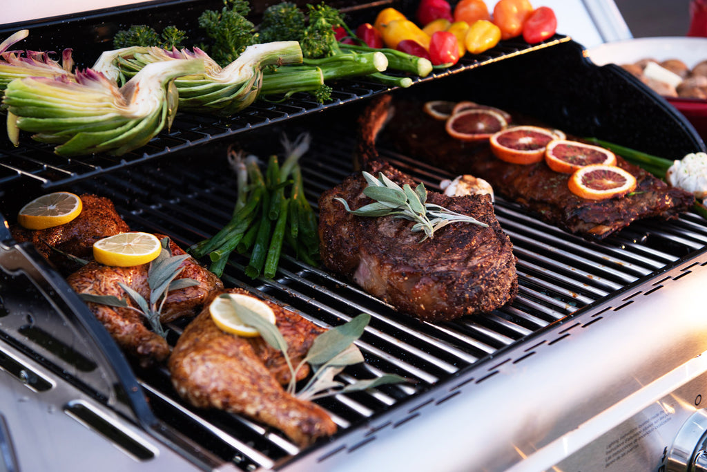 assorted foods on gas grill