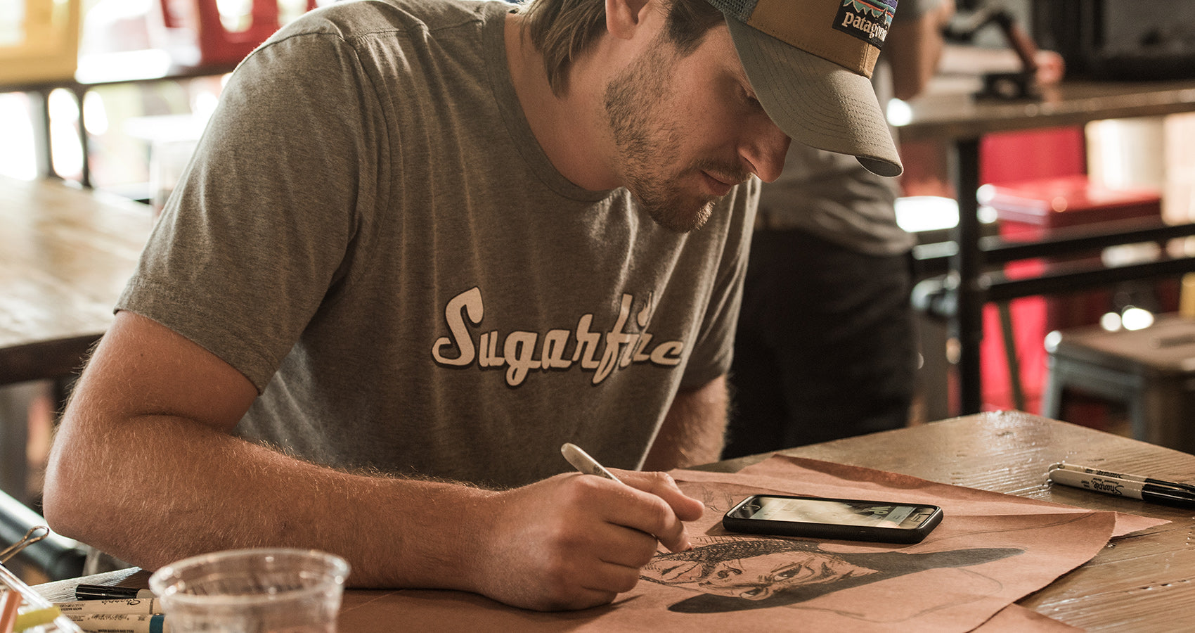matt martin drawing at the table