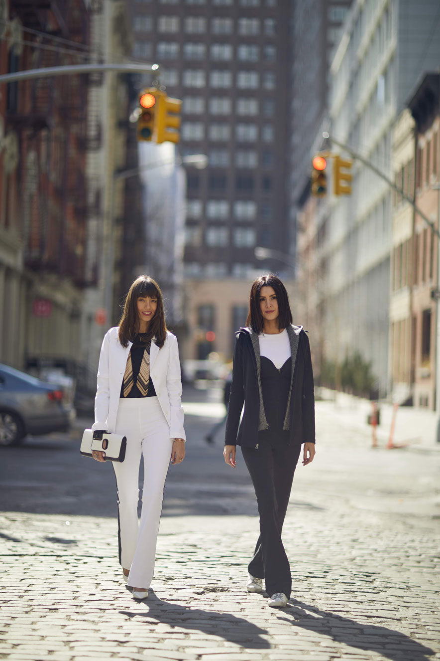 Models Wearing Jacket and Jumpsuit