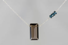 X4SQLBS Smoky Quartz Large Baguette London Blue Topaz Accent Silver Necklace