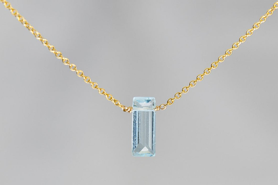 XSBTG Blue Topaz Small Baguette Gold Necklace
