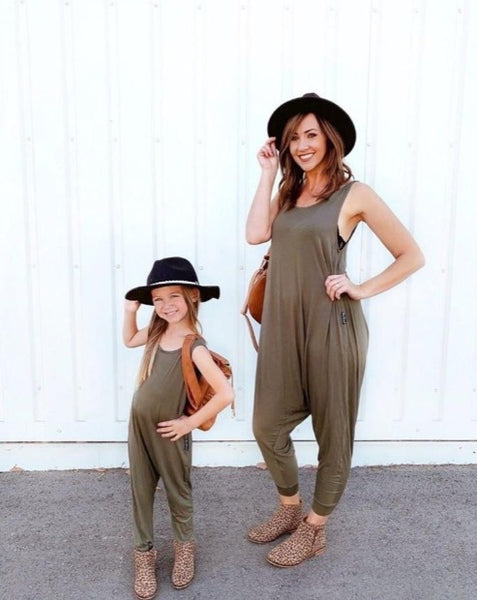 Mom and daughter matching green rompers.