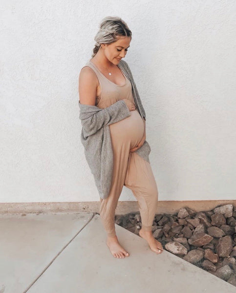 Maternity romper in taupe.