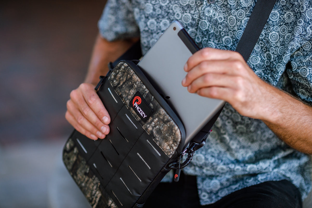 "iPad coming out of 11"" Realtree Timber Camo iPad Capsule in the city"