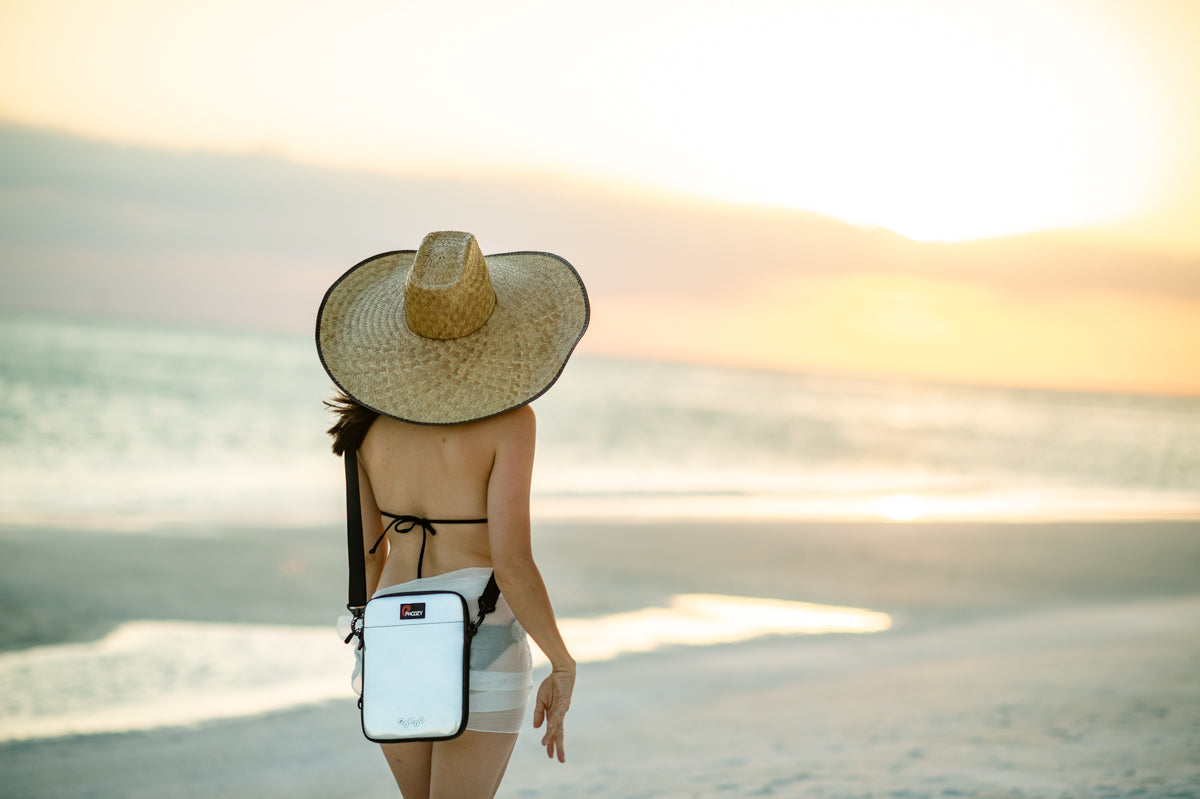 Girl at beach with Iridium Silver iPad Capsule over shoulder